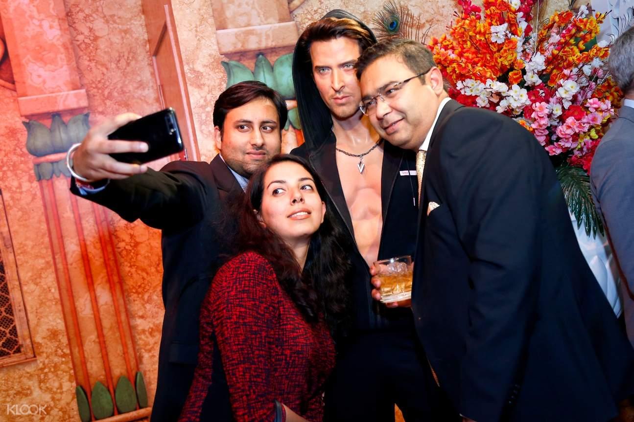 tourist taking a picture in madame tussauds delhi